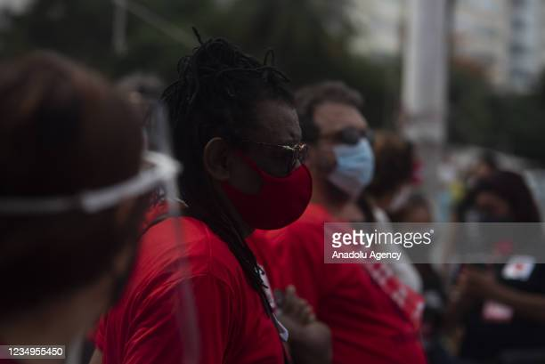 Supporters of former President Luis Inacio Lula da Silva take part in a protest on Copacabana Beach, south of the city, calling for the impeachment...