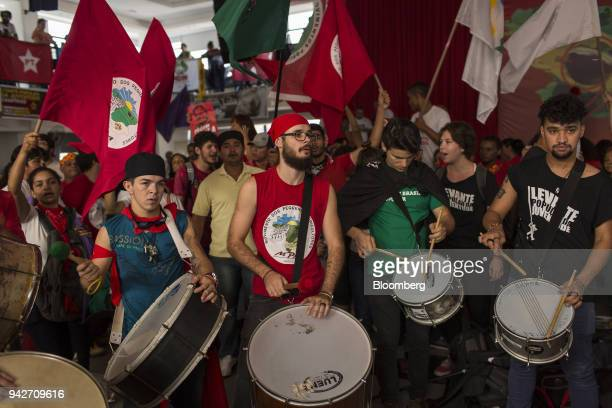 Supporters of former President Luiz Inacio Lula da Silva play music during a protest against Lula's arrest warrant outside the metal workers' union...