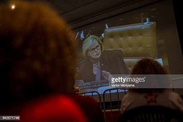 Supporters of former President Luiz Inacio Lula da Silva watch Justice Rosa Weber whose position had not been known but who voted at a session of the...