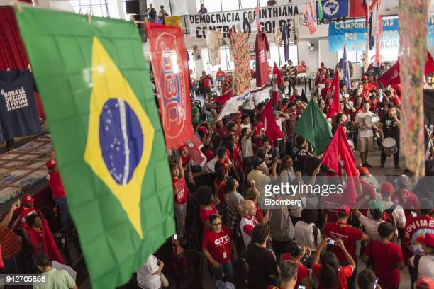 Supporters of former President Luiz Inacio Lula da Silva wave flags during a protest against Lula's arrest warrant outside the metal workers' union...