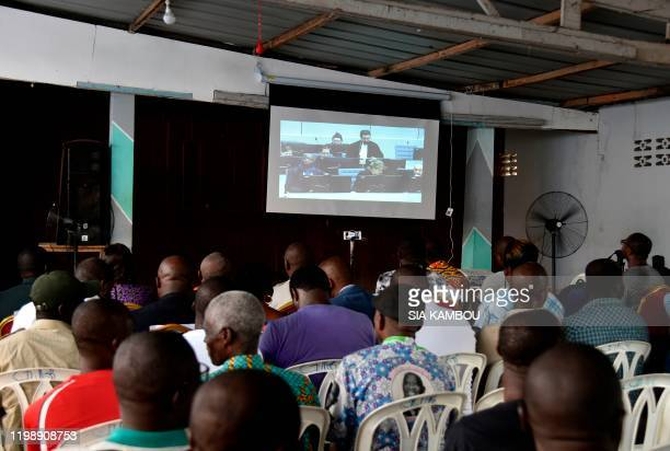 Supporters of former President of Ivory Coast Laurent Gbagbo follow proceedings of the International Criminal Court trial of him and Ivory Coast...