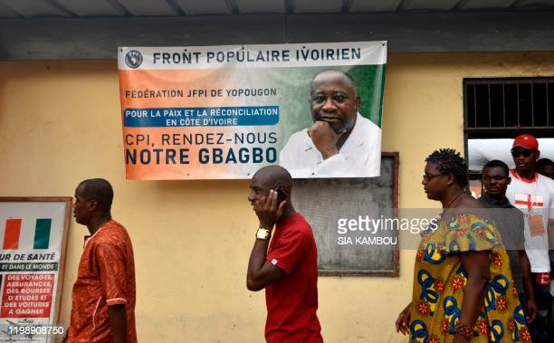 Supporters of former President of Ivory Coast Laurent Gbagboarrives at the Baron de Yopougon to follow proceedings of the International Criminal...