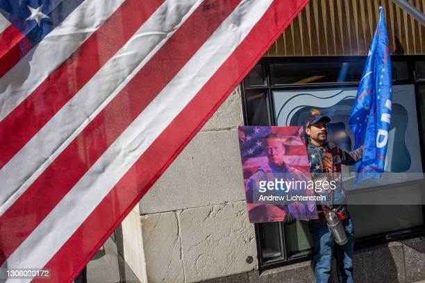Supporters of former President Trump gather outside of Trump Tower during a rare visit Trump made to his New York offices, March 8 in midtown...