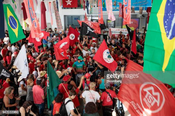 Supporters of former PresidentLuiz Inacio Lula da Silva react while watching the Supreme Court's sentence ruling at the Metal Worker's Union in Sao...