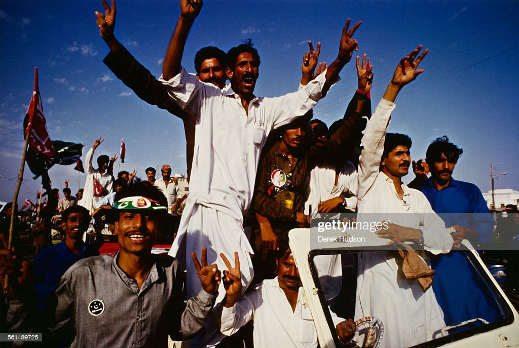 Supporters of former Prime Minister of Pakistan, Benazir Bhutto, gather in Lyari, a neighbourhood of Karachi, Pakistan, to hear her speak, 11th October 1990. Bhutto denounced the recent arrest of her husband, Asif Ali Zardari, as part of a plot to discredit the family.