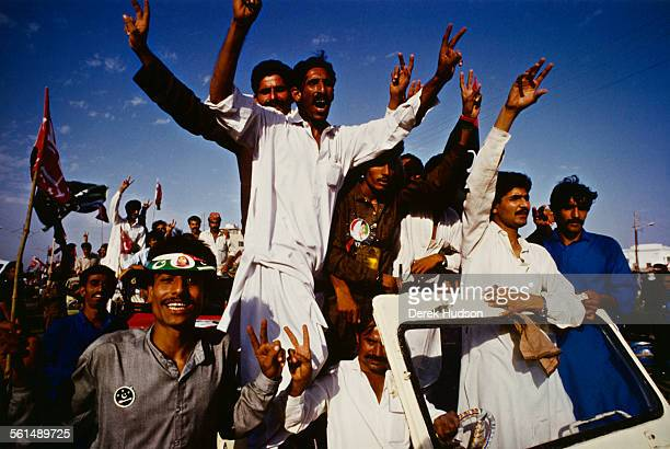 Supporters of former Prime Minister of Pakistan Benazir Bhutto gather in Lyari a neighbourhood of Karachi Pakistan to hear her speak 11th October...