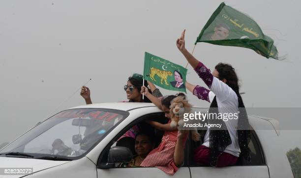 Supporters of former Prime Minister of Pakistan Nawaz Sharif attend a rally to show solidarity during his departure from Islamabad to Lahore on...