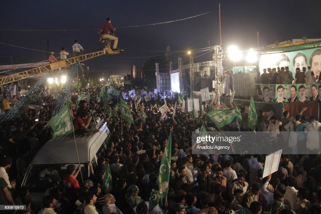 Supporters of former Prime Minister of Pakistan Nawaz Sharif gather during a rally in Lahore Pakistan on August 12 2017