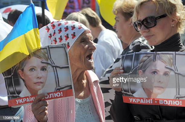 Supporters of former Prime Minister of Ukraine Yulia Tymoshenko picket in front of the appeal court of Kiev on August 12 2011 A Ukrainian court...