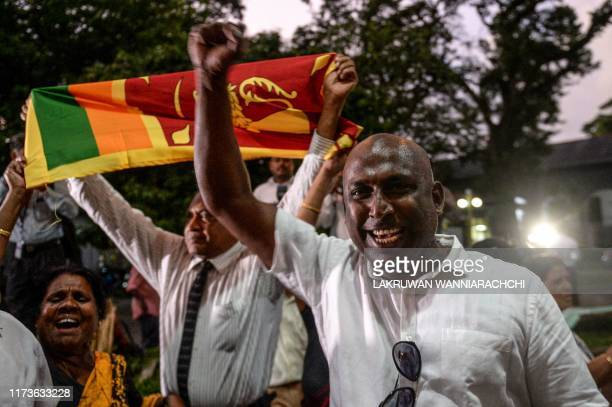 Supporters of former secretary to the ministry of defence and presidential candidate Gotabaya Rajapaksa celebrate outside Sri Lanka's Court of Appeal...