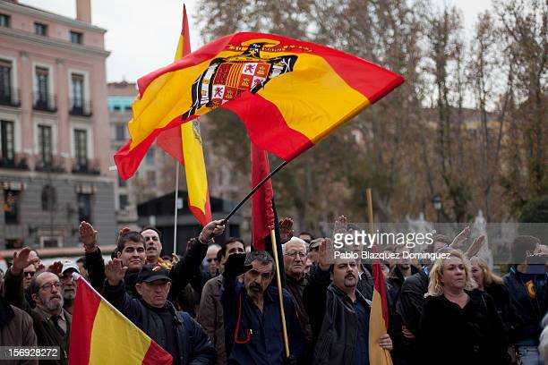 Supporters of former Spanish dictator General Francisco Franco give fascist salutes during a rally commemorating the 37th anniversary of Spain's...
