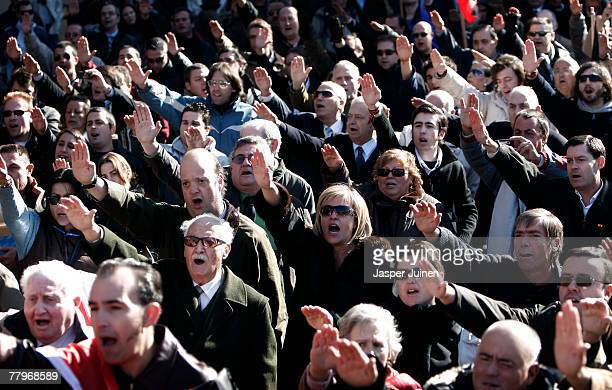 Supporters of former Spanish dictator General Francisco Franco give fascist saluts during a rally commemorating the 32nd anniversary of Spanish...