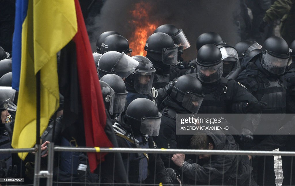Supporters of former the Georgian president clash with police in front of the Ukrainian Parliament in Kiev