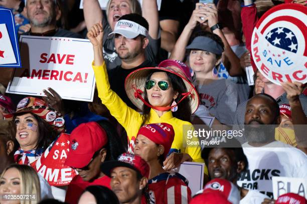 Supporters of former US President Donald Trump cheer at a rally on September 25, 2021 in Perry, Georgia. Republican Senate candidate Herschel Walker,...