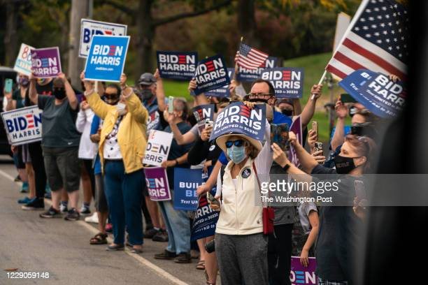 Supporters of Former Vice President and presidential nominee Joe Biden line up along the road in Erie, PA on October 10, 2020.