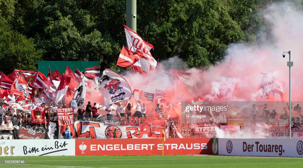 Supporters of Fortuna Duesseldorf are firing Bengalos during the DFB Cup first round match between TuS RW Koblenz and Fortuna Duesseldorf at Stadion Oberwerth on August 19, 2018 in Koblenz am Rhein, Germany.