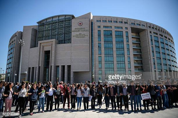 Supporters of four jailed Turkish academics gather in front of the Istanbul courthouse during their trial on April 22 2016 in istanbul our Turkish...
