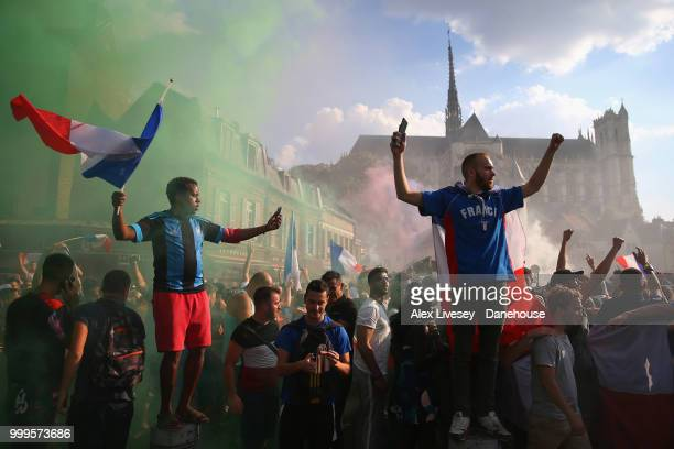 Supporters of France celebrate on the in front of Amiens Cathedral after watching their team win the 2018 FIFA World Cup Final in Russia after the...