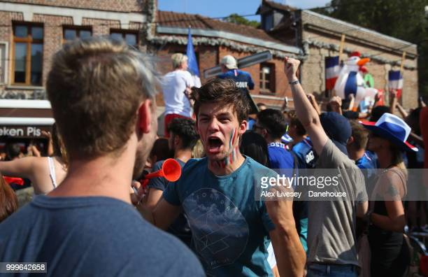 Supporters of France celebrate on the streets of Amiens after watching their team win the 2018 FIFA World Cup Final in Russia after the match between...