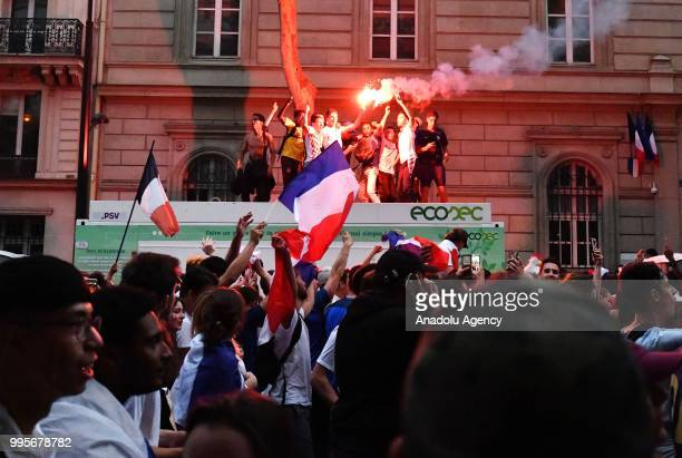 Supporters of France football national team celebrate their team's victory against Belgium of the semifinal match in the FIFA 2018 World Cup in Paris...