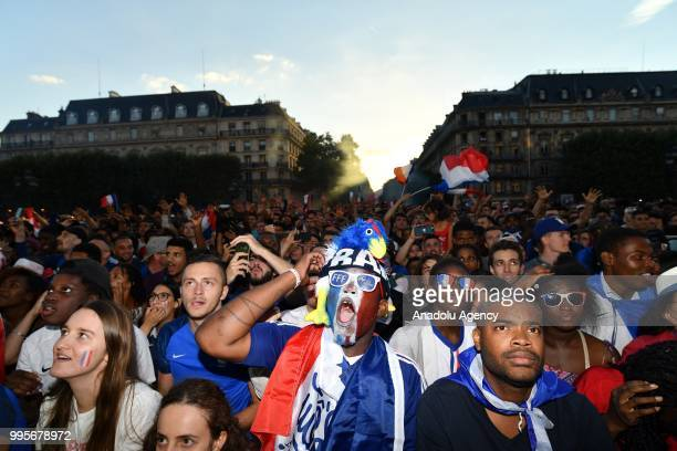 Supporters of France football national team celebrate their team's victory against Belgium of the semifinal match in the FIFA 2018 World Cup in front...