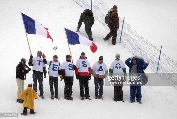 Supporters of France's Tessa Worley cheer during the women's giant slalom 1st run at the World Ski Championships on February 12 2009 in Val d'Isere...