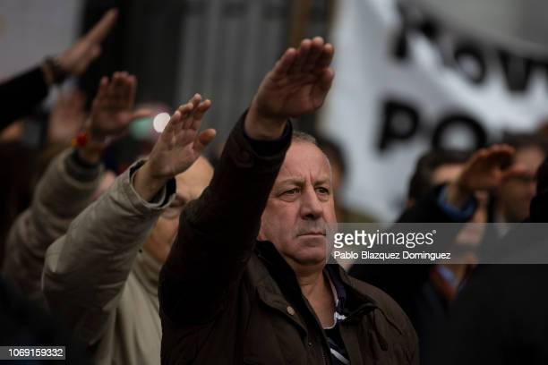 Supporters of Franco do the fascist salute during a rally commemorating the 43rd anniversary of Spain's former dictator General Francisco Franco's...