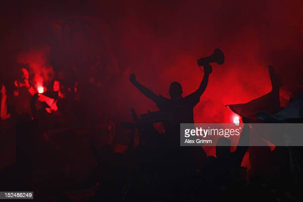 Supporters of Frankfurt burn flares prior to the Bundesliga match between 1 FC Nuernberg and Eintracht Frankfurt at Easy Credit Stadium on September...