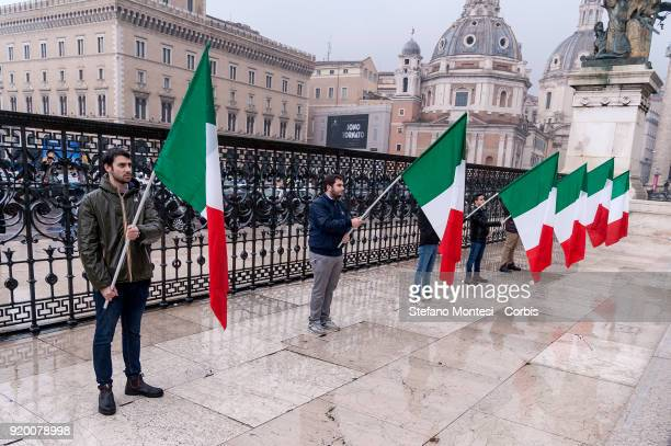 Supporters of Fratelli d'Italia party with the italian flag after the event at the Adriano Cinema to the Altar of the Fatherland for the deposition...