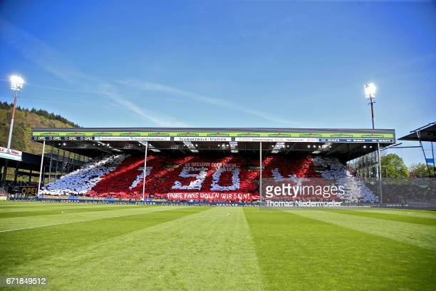 Supporters of Freiburg are seen during the Bundesliga match between SC Freiburg and Bayer 04 Leverkusen at SchwarzwaldStadion on April 23 2017 in...