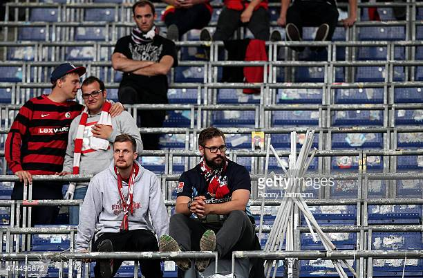 Supporters of Freiburg look dejected after the Bundesliga match between Hannover 96 and SC Freiburg at HDIArena on May 23 2015 in Hanover Germany