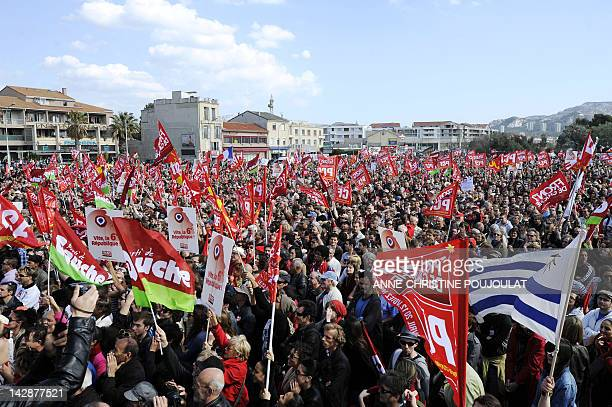 Supporters of French Front de Gauche leftist candidate for the 2012 French presidential election listen to his speech during a campaign meeting on...