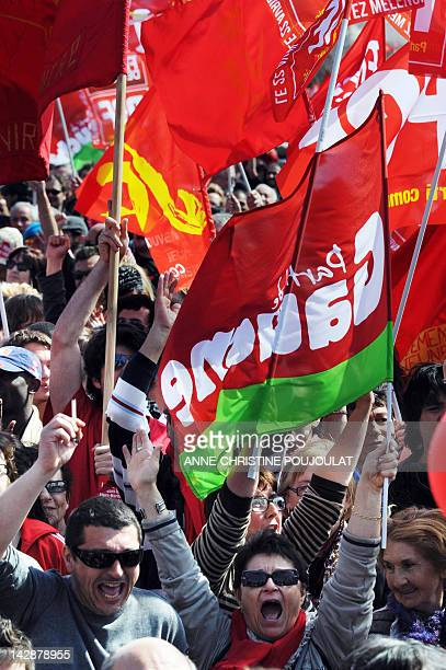 Supporters of French Front de Gauche leftist candidate for the 2012 French presidential election JeanLuc Melenchon react during a campaign meeting on...