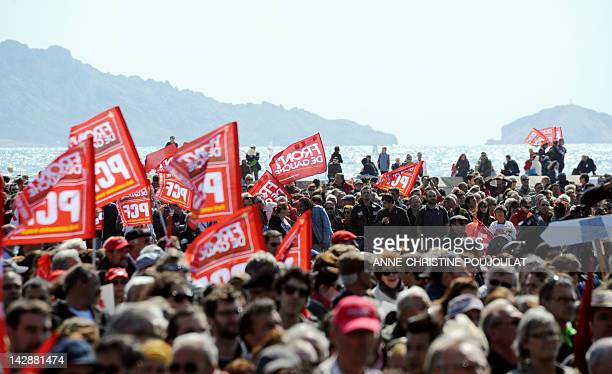 Supporters of French Front de Gauche leftist party's candidate for the 2012 French presidential election wave flags during a campaign meeting on...