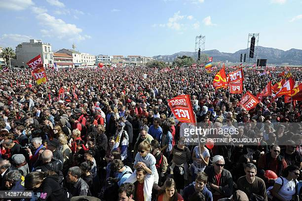 Supporters of French Front de Gauche leftist party's presidential candidate listen to his speech in a campaign meeting on April 14 2012 at the Plage...