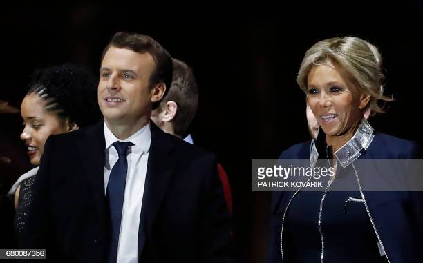 Supporters of French presidentelect Emmanuel Macron and his wife Brigitte Trogneux react at the Louvre Museum in Paris on May 7 after the second...