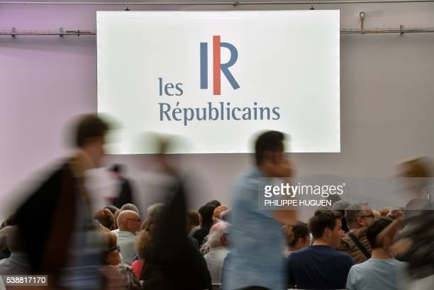 Supporters of French right-wing party Les Republicains arrive to attend a party meeting on June 8, 2016 in Saint-Andre-lez-Lille, northern France. /...