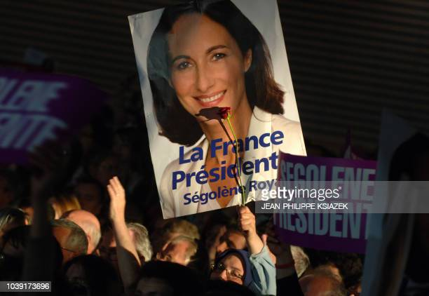 Supporters of French Socialist party presidential candidate Segolene Royal attend a campaign meeting 27 April 2007 in Lyon nine days before the...