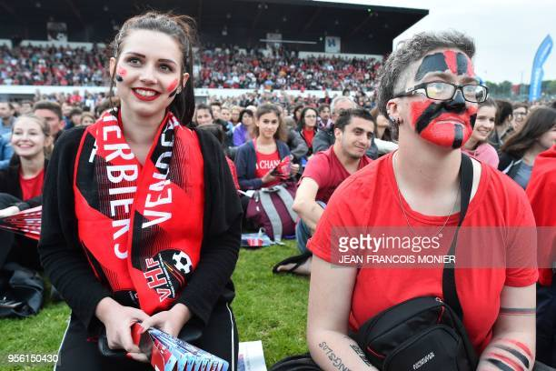 Supporters of French third division football club 'Les Herbiers' react at the stadium in Les Herbiers western France on May 8 to watch on a giant...