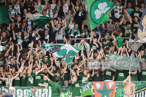 Supporters of Fuerth cheer their team during the Second Bundesliga match between SpVgg Greuther Fuerth and Arminia Bielefeld at Playmobil Stadium on...