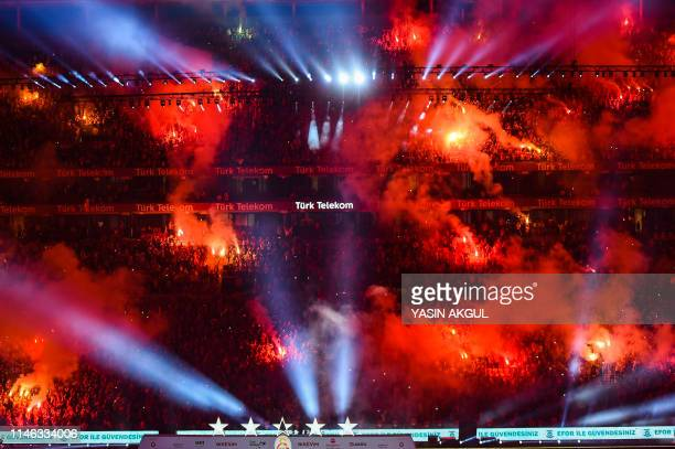 Supporters of Galatasaray celebrate during a trophy ceremony after the football club won the Turkish Super League 2018-2019 title at the Turk Telekom...