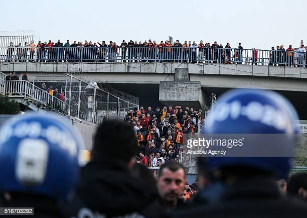 Supporters of Galatasaray leave Turk Telekom Arena after the Turkish Spor Toto Super Lig match between Galatasaray and Fenerbahce was postponed due...