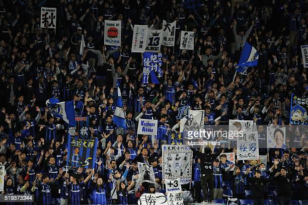 Supporters of Gamba Osaka cheer prior to the AFC Champions League Group G match between Gamba Osaka and Shanghai SIPG FC at the Suita City Football...