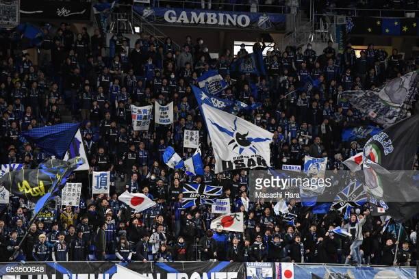 Supporters of Gamba Osaka cheer prior to the AFC Champions League Group H match between Gamba Osaka and Jiangsu FC at Suita City Football Stadium on...