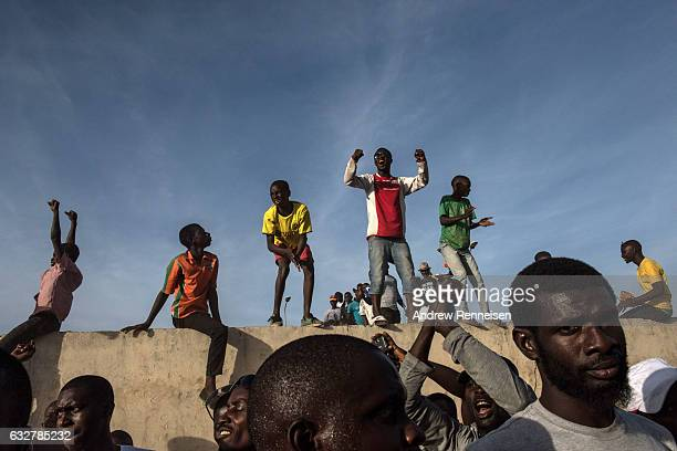 Supporters of Gambian President Adama Barrow cheer as he leaves Banjul International Airport on January 26 2017 in Banjul The Gambia Barrow had been...