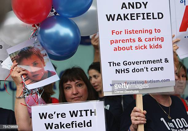 Supporters of gastroenterologist Dr Andrew Wakefield hold placards outside the GMC on July 16 2007 on London England Wakefield is appearing before...