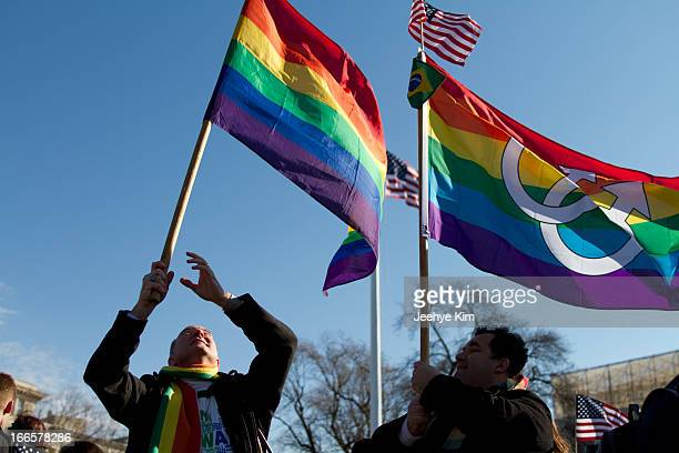 Supporters of gay marriage hold rainbow flags during the DOMA and Prop 8 hearing at the Supreme Court in March 2013.