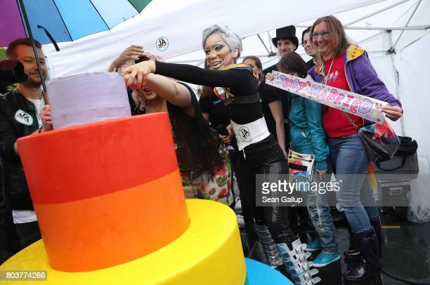 Supporters of gay rights gathered outside the Chancellery cut a cake to celebrate a vote at the nearby Bundestag in which parliamentarians approved a...