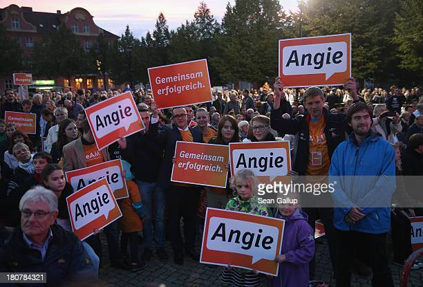 Supporters of German Chancellor and Chairwoman of the German Christian Democrats Angela Merkel attend a CDU election rally at which Merkel spoke on...
