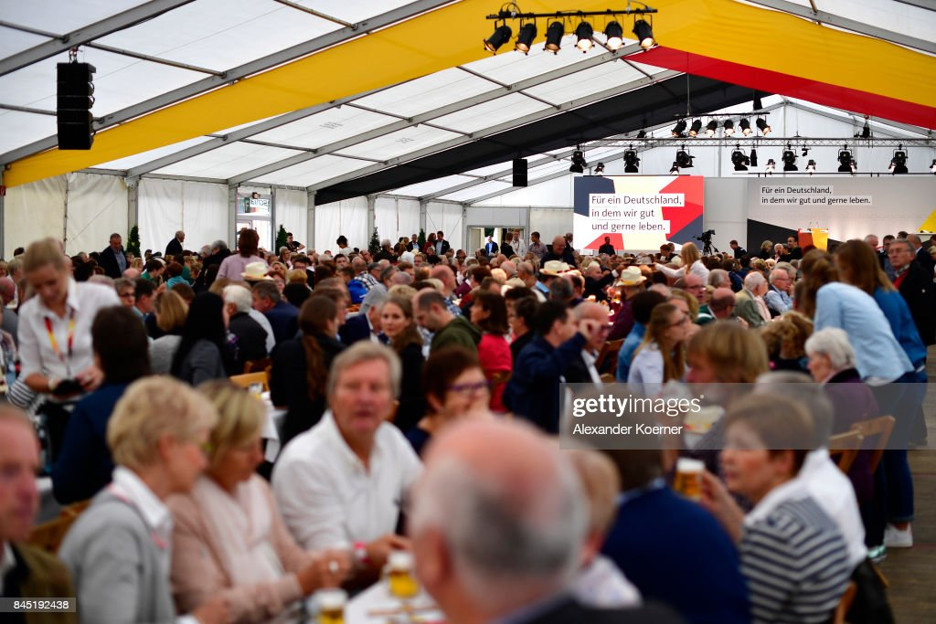 Supporters of German Chancellor and Christian Democrat (CDU) Angela Merkel (not pictured) sit and wait prior to a speech to supporters at a fest tent during an election campaign stop on September 10, 2017 in Delbruck, Germany. Merkel is seeking a fourth term in federal elections scheduled for September 24 and currently holds a strong lead over her main rival, German Social Democrat (SPD) Martin Schulz.